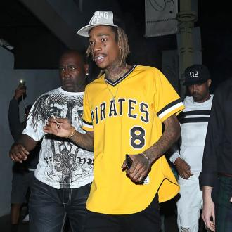 Wiz Khalifa handcuffed for 'refusing to get off his hoverboard'