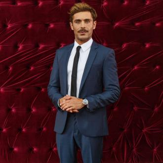 Zac Efron says Hugh Jackman cannot calm down
