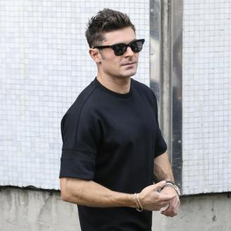 Zac Efron goes litter picking in London