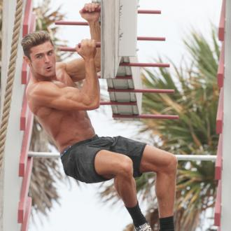 Zac Efron never wants his ripped Baywatch body back