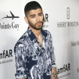 Zayn Malik was told to quit One Direction by 'an alien'