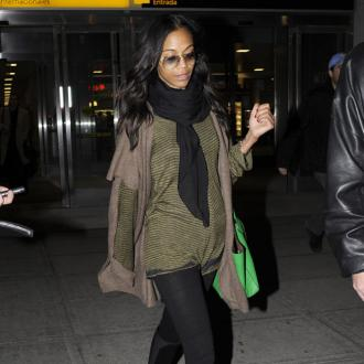 Zoe Saldana Besotted With New Man