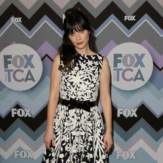 Zooey Deschanel Loves Little Saint Nick